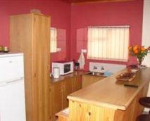 Open plan kitchen/ lounge, TVKettle, microwave, hot plate freezer/fridge cutlery crockery,                         fireplace and portable braai. © S.A.Bruwer