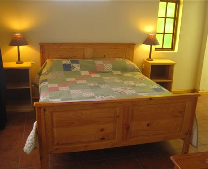 A queen-size bed with an en-suite bathroom.