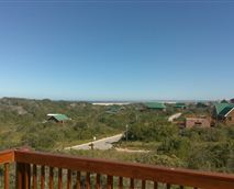 From the upper viewing deck. Sunbathe in privacy apart from the rest of the establishment, views of the whole valley and village, with surrounding bush, sea view and night lights of the distant Jeffreysbay