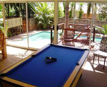 View of the pool table and swimming pool.