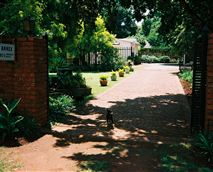 Entrance and driveway to parking area.