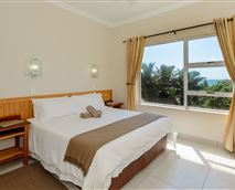 Catch a glimpse of the sea views from the main bedroom