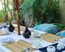 There are two main patio areas for your relaxation and enjoyment. This is the main breakfast patio which is very secluded and peaceful. Breakfast is served out here weather permitting. A full continetal and or hot breakfast is available.
