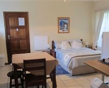 2 rooms, one with double bed, other with 2 single beds