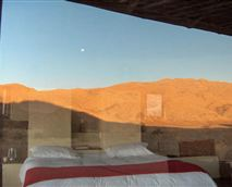 Situated in the peaceful solitude of an idyllic valley, in the heart of the desert, Kuangukuangu is the ideal place for travellers who seek tranquillity and intimacy. Nestled in a dune, KuanguKuangu makes it possible for its occupants to live in harmony with nature, at the same time offering them comfort, luxury, adventure and relaxation.