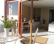 Apartment (Luxury) -Sliding doors to the sea view patio.