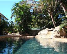 Beautiful rock features and plentiful palms and plants surround Lalapanzi's beautiful saltwater pool.