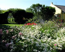Cottage and arch to vegetable garden