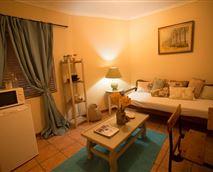 Comfortable lounge area with fridge, coffee & tea facilities, home-made rusks!