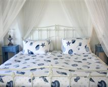 Our most spacious room. The American-sized canopy king bed might be the only one of its kind in Cape Town.