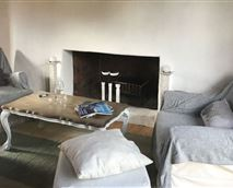 Comfortable sitting area with fireplace for those romantic winter evenings
