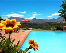 View of the flowers and pool at Far Hills Hotel.