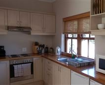 Kitchen is fully equipped for self catering, with a fridge and freezer, microwave and built-in stove and oven.