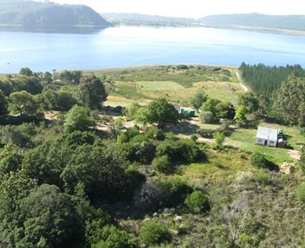 Aerial view of Log Cabins.  The Small Cabin is behind the trees to the right of the green water tanks.