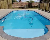 Fenced swimming pool