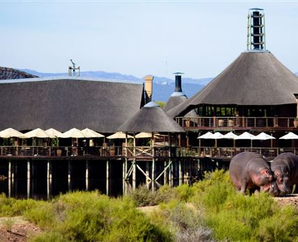 A brilliant view of the main Lodge and Restaurant overlooking the waterhole where wildlife can be viewed from the deck.