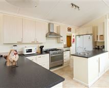 The spacious, fully equipped communal kitchen is located upstairs.