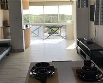 Open plan kitchen to lounge with sea view