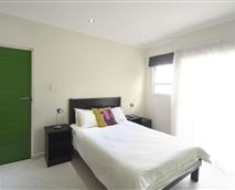 Deluxe Double (En Suite) Room which opens onto Communal Balcony and Braai Area