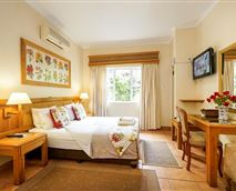 Room en-suite, queen size bed. Air-conditioned  with tea coffee making facilities, hairdryers, small bar fridge,  electronic safes, TV (dstv) ,euro-outlets for charging cellphones /computers, comes complete  with guest amenities.