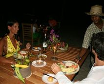 Request a perfectly set dinner for two on the beachfront under the moonlight