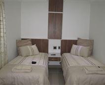 Room has 2 single beds and en-suite bathroom (Shower).