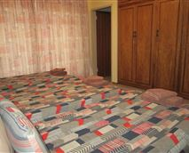 Rooms 2-6 have either 3 single beds, or a double bed and 1 single bed.
