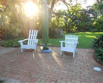 relaxing chairs metres from pool and gas braai