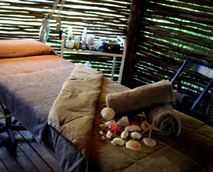 Relax and enjoy spa treatments in private thatched lapas.