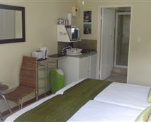Suite to accommodate two single guests or couple with a full en-suite and kitchenette