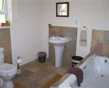 spacious Full Bathroom shower, bath, basin and toilet