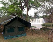 Tents pitched near the waterfall and river