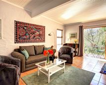 The spacious open plan interior offers a bathroom, kitchenette and sunny patio.
