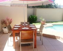 Outside dining area and swimming pool