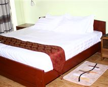 Spacious, comfortable Executive rooms with king-size bed, DStv and WI-FI connections