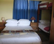 Room One with queen-size bed and a double-bunk bed