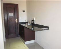 Each room has a small kitchenette area