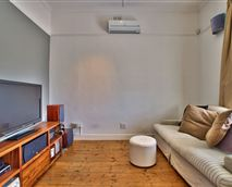 TV room with satellite TV and DVD player