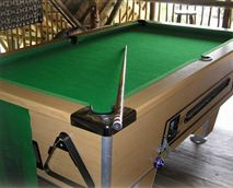 Upstairs we have a pool table and a mini gym area where guests can relax or work out
