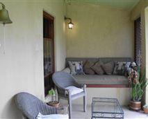 A private veranda overlooks the garden