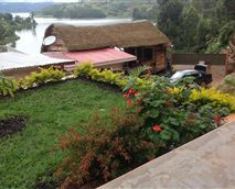 Wake up to singing of the beautiful birds, relax and a read a book in our garden, enjoy the sunset and view © Bunyonyi View