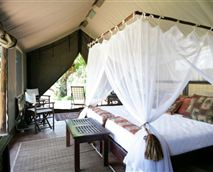 The Luxury tent has got 2 3/4 beds, with mosquito nets, private veranda overlooking the bush, en suite bathroom with Victorian bath and outside shower, tea and coffee.