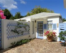 The Garden Cottage stands separately with its own enclosed garden and braai area.