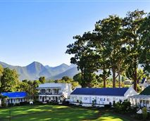 View of village rooms and Tsitsikamma mountains as backdrop © Irma de Villiers