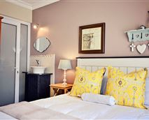 Double bed with a shower and toilet on-suite, bar fridge with coffee and tea facilities