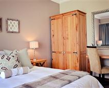 Queen bed with bath, shower and toilet separately, bar fridge with coffee and tea facility.