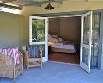 Garden suite opening onto a covered veranda