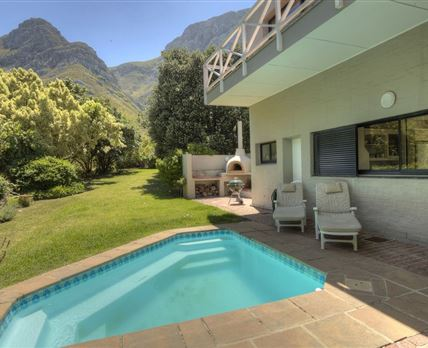 Sheltered pool and braai patio facing the mountain