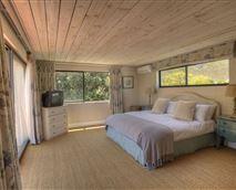 Upstairs en-suite bedroom with lounge, patio and tea kitchen
