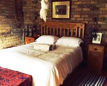 Bedroom 1 - queen bed w ensuite shower and toilet